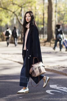 Korean model Sung Hee Kim carries her Tod's Wave Bag in the East...