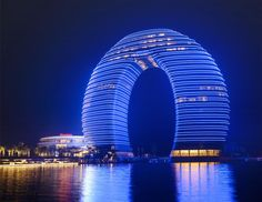 50 Exotic Hotels Around The World Horseshoe Hotel, Sheraton Huzhou Hot Spring Resort, Huzhou, Zhejiang, China Unusual Buildings, Interesting Buildings, Amazing Buildings, Contemporary Buildings, Famous Buildings, Architecture Unique, Futuristic Architecture, China Architecture, Ancient Architecture