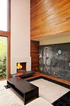 Modern fireplace idea  Northwest Residence by Coop 15 Architecture