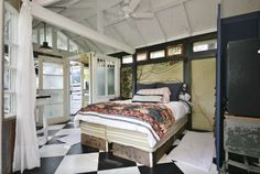 Explore the interior of this cozy guest house with an outdoor bathroom