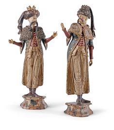 A pair of Italian polychrome painted carved wooden figures, Venetian,18th Century.