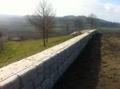 The CPM Redi-Rock hostile vehicle mitigation walling  system is used to guard buildings of high importance without drawing much attention