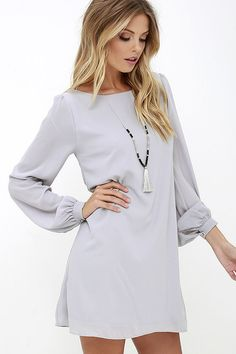 "Lulus Exclusive! Why ""hashtag"" it out with your old dresses, when you can post up in the Status Update Light Grey Shift Dress?! A simple woven poly bodice includes long puffed sleeves with gold-buttoned cuffs, and a scoop neckline. This day-to-night look is remarkably easy to style, and as fun as it is affordable!"