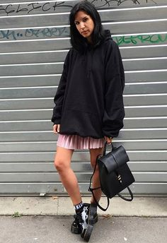 A black hoodie will score you a sartorial home run this season as the Vetements dream-saga continues. Style it with a pink pleated mini and 90s slogan ankle socks, or add some oversized fishnet tights for more of a vibe. Dr Martens are guaranteed to land the look