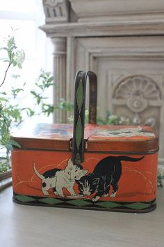 Vintage biscuit tin with black white cats.