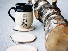 Slice off pieces from a birch limb and use them as coasters! It doesn't get any cheaper than this! Then paint with a sealant and tada...