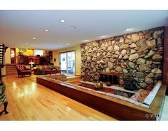 1978 Flossmoor, IL family room with a stone fireplace and sunken conversation pit