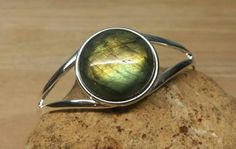 Check out this item in my Etsy shop https://www.etsy.com/listing/229294946/labradorite-bracelet-reiki-attuned-cuff