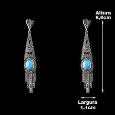Brinco de Prata com Opala. Prata 925.Joia em formato comprido, possui 1 pedra de Opala na cor azul e aproximadamente 50 pedras de Marcassitas. Brinco de tarraxa.Marcassita é o nome popular dado ao minério de Sulfeto de Ferro.