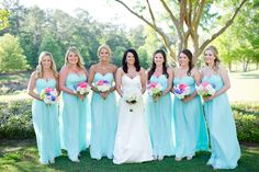 bridesmaids in aqua chiffon dresses with summer hued bouquets