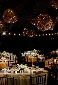http://Brides.com: . Grapevine balls entwined with string lighting twinkle like stars in the sky.