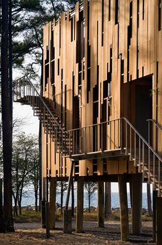 The Loblolly House uses the forest and surrounding landscape as inspiration for its siding. The staggered vertical siding reflects the verticality of the forest. The panels also act as a rain screen, shedding most of the water and allowing for natural air movement through the structure. I like how the panels are both symbolic and functional and create an interesting design.