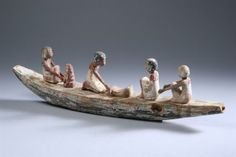 Egyptian wooden funerary boat model,  Middle Kingdom, 1980- 1630 B.C. - 5.5 in x 20 in.