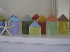 So sweet and beachy, just the thing for your coastal look. Colorful beach houses are hand cut and painted. Each one is different and one of a kind