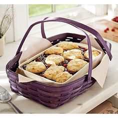 "Large Everyday Essentials Basket Big enough to hold our 9"" x 13"" Lidded Baking Dish with room to spare. Solid wood bottom and sturdy swinging handles make carrying your homemade dishes to get togethers a breeze. Also carries our 8-in-1 Entertainer, 8"" x 8"" Baking Dish, Longaberger Flameware® 10 1/2"" Lidded Braiser, two 4 Quart Lidded Dutch Ovens and two 2 1/4 Quart Lidded Dutch Ovens. Protector available separately. Made in the U.S.A. 20 3/8""l x 14 1/4""w x 4 3/8""h; Rec. Wt. Use: 30 lbs."