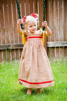 VERY CUTE!!  1.)  Measure your child's length from armpit to where you want the bottom of  the dress to fall.