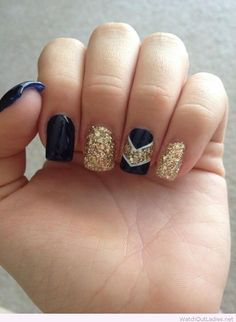 Navy and gold glitter nail art design