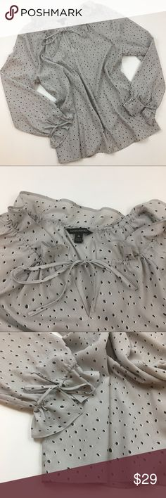 """Banana Republic Gray Polka Dot Tie Front Blouse Gorgeous Blouse in EUC! The print is so cute and the tie detail on the neck and sleeves is so great. Perfect for work. The neck is very adjustable and offers a lot of different options for wear! Barely worn, washing instructions tag is cut out but it is in perfect shape. Ask any questions! 💕 approx measurements: 22"""" bust, 26"""" length Banana Republic Tops Blouses"""