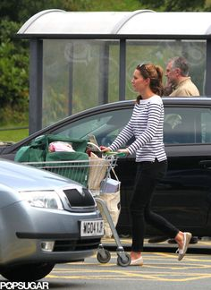 It's the first time we've seen Kate Middleton since she left the hospital with Prince William and their son, Prince George, last month! Sporting a simple striped sweater and a ponytail, the new mom was spotted shopping at the local market on the island of Anglesey. August 26, 2013
