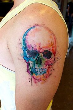 Water colour tattoo really like the colours and technique but I can't pull off skulls