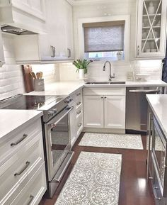 To improve the interior of your home, you may want to consider doing a kitchen remodeling project. This is the room in your home where the family tends to spend the most time together. If you have not upgraded your kitchen since you purchased the home,. Kitchen Rug, New Kitchen, Kitchen Decor, Kitchen Cabinets, Upper Cabinets, Island Kitchen, Small White Kitchens, Kitchen White, Kitchen Views