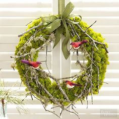 Combine lush moss, foraged branches, and feathered birds (from the crafts store, of course!) to make this elegant, holiday-ready wreath. Finish with ribbon and display on a window or over the mantel. Total cost: $10/