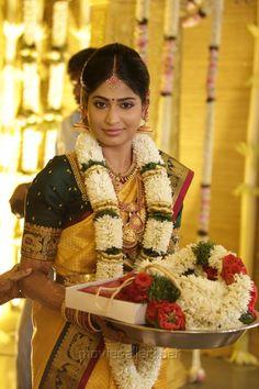 South Indian bride. Temple jewelry. Jhumkis. Mustard yellow silk kanchipuram sari with contrast green blouse.Braid with fresh jasmine flowers. Tamil bride. Telugu bride. Kannada bride. Hindu bride. Malayalee bride.Kerala bride.South Indian wedding.