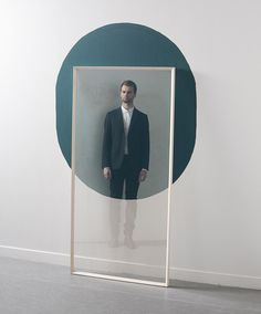 """Reflet Mirror ~ designed by Claire Lavabre """"only works when it's placed in front of a dark shape painted on the wall.… a partial reflection is visible in the beveled frame if it is placed in front of a white surface but the reflection becomes clear when the glass overlaps with dark matte paint."""" via Dezeen"""
