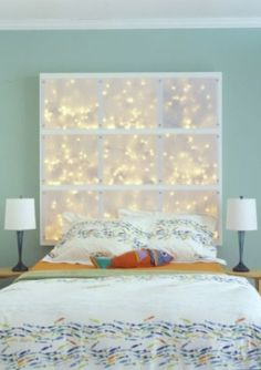 Easy DIY: Using sheer cloth on a simple wood frame with string lights in the background make a very iconic head board! (I think I might do this...)