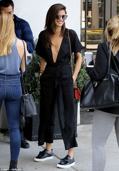 Taking the plunge! The 25-year-old supermodel stood out from the crowd in a deep-V black r...