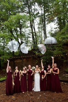 Blake dressed her girls in different mismatched styles in the color Wine by Bill Levkoff.  The end result is gorgeous!  We love that they didn't let a little rain stop them from enjoying the wedding!