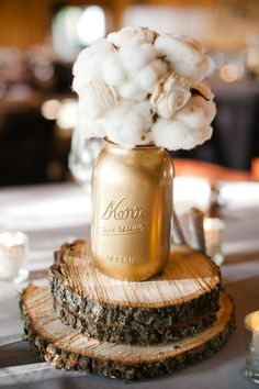 Gold Painted Mason Jar with cotton on wood. #centerpiece #table #wedding