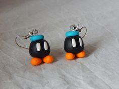 Boucles d'oreille Bombes noires de Mario en pâte polymère, réalisées par La Caverne des Geek sur A Little Market. N'hésitez pas à aller jeter un œil. =) https://www.alittlemarket.com/boutique/la_caverne_des_geek-1476567.html