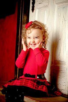 cute girl in red with adorable curls