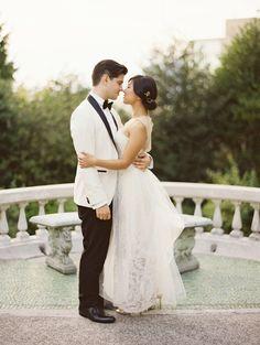 Great groom style | white jacket! black lapels | Modern Black and White Manor Wedding via oncewed.com
