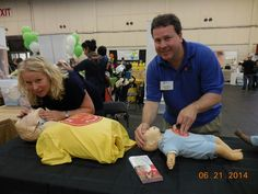 Charles + Laura Seidel, demonstrating mouth-to-mouth resuscitation, part of their SAFETY TRAINING SEMINARS. cprcpr.com, offering classes in 10 Bay Area cities.