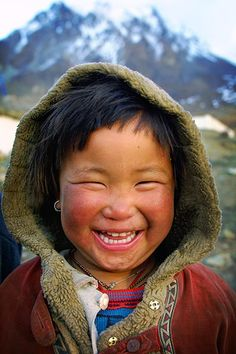 Smiling child even in the cold