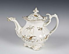 A STAFFORDSHIRE POTTERY TEAPOT, 19TH CENTURY, the lobed body with Ho-Ho bird spout and pagoda finial,