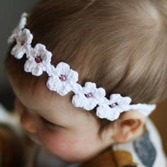 Daisy Headband Crochet PDF Pattern by Loralou's Booteequee    Crochet this adorable band for your little girl this Spring to welcome the warmer weather :)    Sizing: The band can be made in any size to fit perfectly!    Materials needed:  • A 3.5mm crochet hook  • Yarn (I used DK weight yarn)  • Optional beads for the centre of each daisy  • A needle...