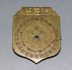 Vintage 1936 Badge-Shaped Little Orphan Annie Decoder Pinbadge with a Secret Compartment on the Back.  Ralphie!!