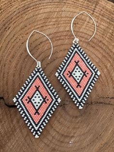 Navajo style earrings in a color scheme of matte black and white beads and a slightly glossy pink. Sterling silver filled long earring hooks finish these beauties. These are definitely statement earrings! From top of earring hook to bottom of earring these measure 4.25 inches in length and 1.75 inches wide.