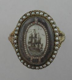 Ship Mourning Ring, c.1785-1790 The ship sailing away from the viewer shows the passage of the soul into the afterlife.  History on the website. http://artofmourning.com/2011/03/15/revisiting-ship-mourning-ring/