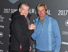 """Celebs at Sundance Pierce Brosnan (L) and American big-wave surfer Laird Hamilton attend the """"Take Every Wave: The Life of Laird Hamilton"""" premiere at The Marc Theatre on Jan. Sundance 2017, Pierce Brosnan, Sundance Film Festival, Big Waves, Celebs, Celebrities, Hamilton, Theatre, American"""