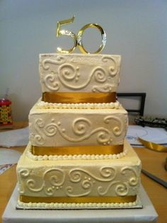 Golden anniversary cake...replace this topper with the couple's original porcelain bride / groom topper from their wedding day.
