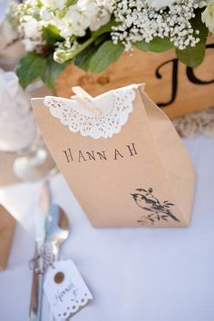 Adorable brown paper favor bags, accented with a doily and sealed with a clothespin. #guest #favor #ideas