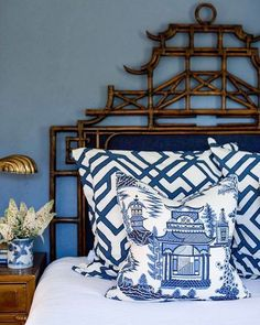 Schumacher A Chinese Chippendale pagoda headboard and blue and white Chinoiserie fabrics combine in this lovely bedroom.
