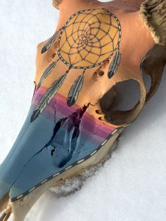 Painted deer skull european mount by Hollie Reilly with a dreamcatcher painted over sunset colors by SorrelHorseStudio on Etsy.