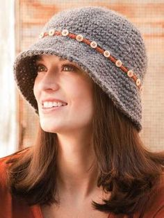 Crochet World Oct Button-Down Cloche pattern by LaVerne Elvee Dickinson A simple chain-stitch band attached with pretty buttons gives a plain hat a touch of pizzazz. Cloche Hat (Crochet pattern) - Love the buttons though, so knit one like this. Crochet Adult Hat, Bonnet Crochet, Crochet Beanie, Knit Or Crochet, Crochet Scarves, Crochet Crafts, Crochet Clothes, Crochet Projects, Knitted Hats