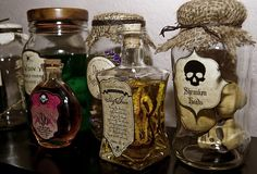 glass jars  -just add some dollar store toys or things you find in your backyard and stick some spooky labels on. You can also add a little pizazz to the tops with some burlap, corks, and twine. Some of the labels were rub on transfers from Michaels. The other labels came from fabulous designer - Kristine McKay - who shares a pdf of these labels you can download for free!