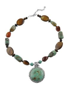 Turquoise, wood beads, and caramel mother-of-pearl.    Barse Jewelry